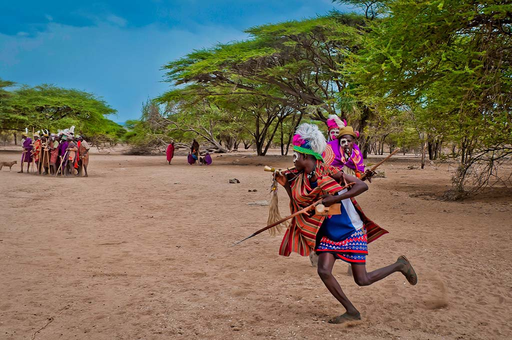 Marco Castro, October 22nd, 2010. Young Turkana Warriors play a battle at the riverbed, close by where a traditional Turkana Wedding is to take place.